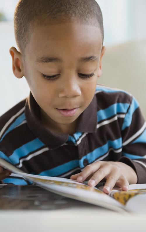Boy Reading - NHIDA Outreach